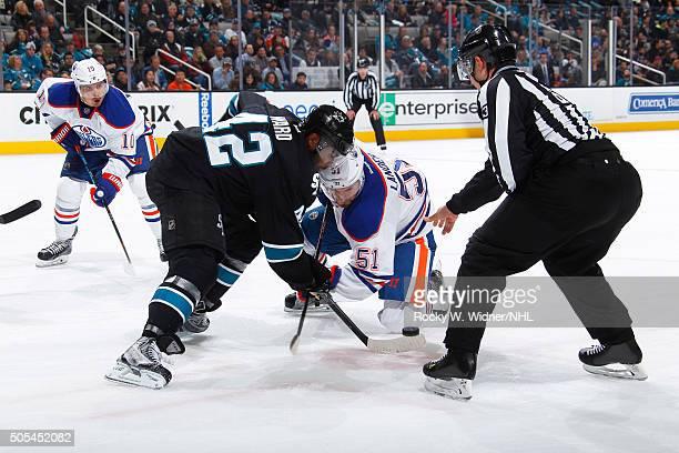 Joel Ward of the San Jose Sharks faces off against Anton Lander of the Edmonton Oilers at SAP Center on January 14 2016 in San Jose California