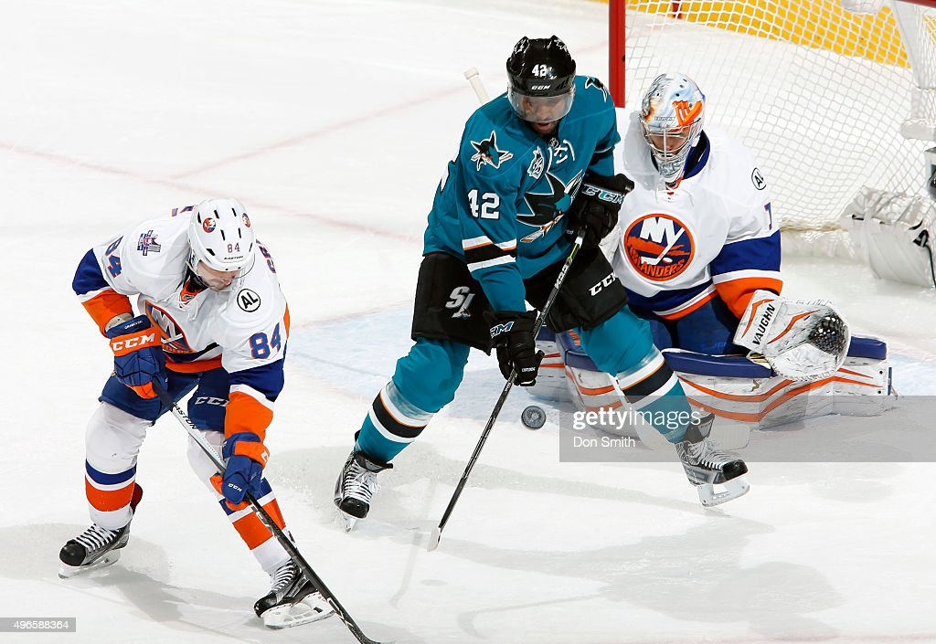 <a gi-track='captionPersonalityLinkClicked' href=/galleries/search?phrase=Joel+Ward+-+Ice+Hockey+Player&family=editorial&specificpeople=7231959 ng-click='$event.stopPropagation()'>Joel Ward</a> #12 of the San Jose Sharks gets a stick on the puck against <a gi-track='captionPersonalityLinkClicked' href=/galleries/search?phrase=Mikhail+Grabovski&family=editorial&specificpeople=2560547 ng-click='$event.stopPropagation()'>Mikhail Grabovski</a> #84 and <a gi-track='captionPersonalityLinkClicked' href=/galleries/search?phrase=Thomas+Greiss&family=editorial&specificpeople=695275 ng-click='$event.stopPropagation()'>Thomas Greiss</a> #1 of the New York Islanders during a NHL game at the SAP Center at San Jose on November 10, 2015 in San Jose, California.