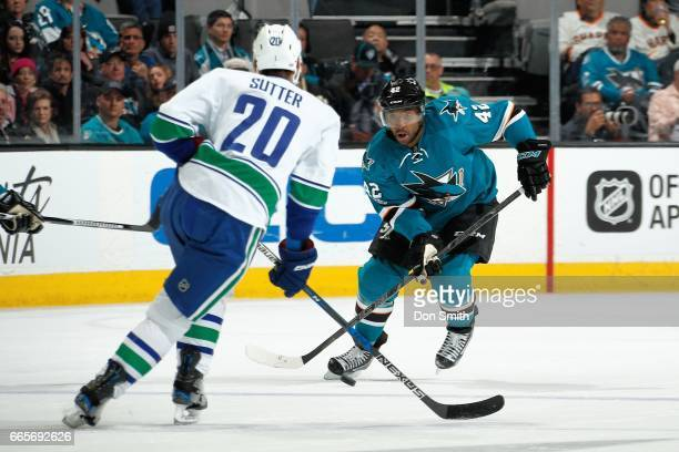 Joel Ward of the San Jose Sharks goes to maneuver the puck around Brandon Sutter of the Vancouver Canucks at SAP Center at San Jose on April 4 2017...