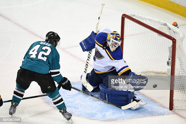 Joel Ward of the San Jose Sharks scores his second goal on Brian Elliott of the St Louis Blues in Game Six of the Western Conference Final during the...