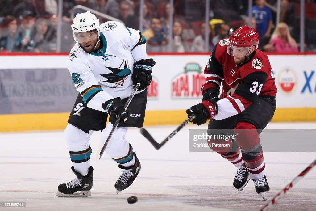 Joel Ward #42 of the San Jose Sharks skates with the puck ahead of Alex Goligoski #33 of the Arizona Coyotes during the third period of the NHL game at Gila River Arena on November 22, 2017 in Glendale, Arizona. The Sharks defeated the Coyotes 3-1.