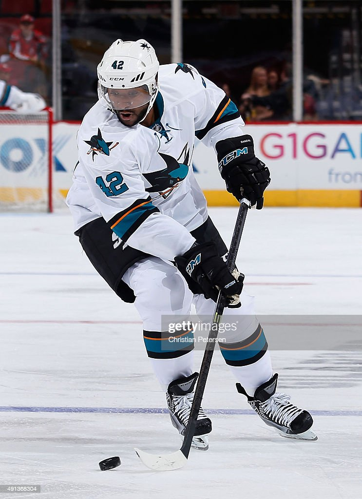 Joel Ward of the San Jose Sharks skates with the puck during the NHL preseason game against the Arizona Coyotes at Gila River Arena on October 2 2015...