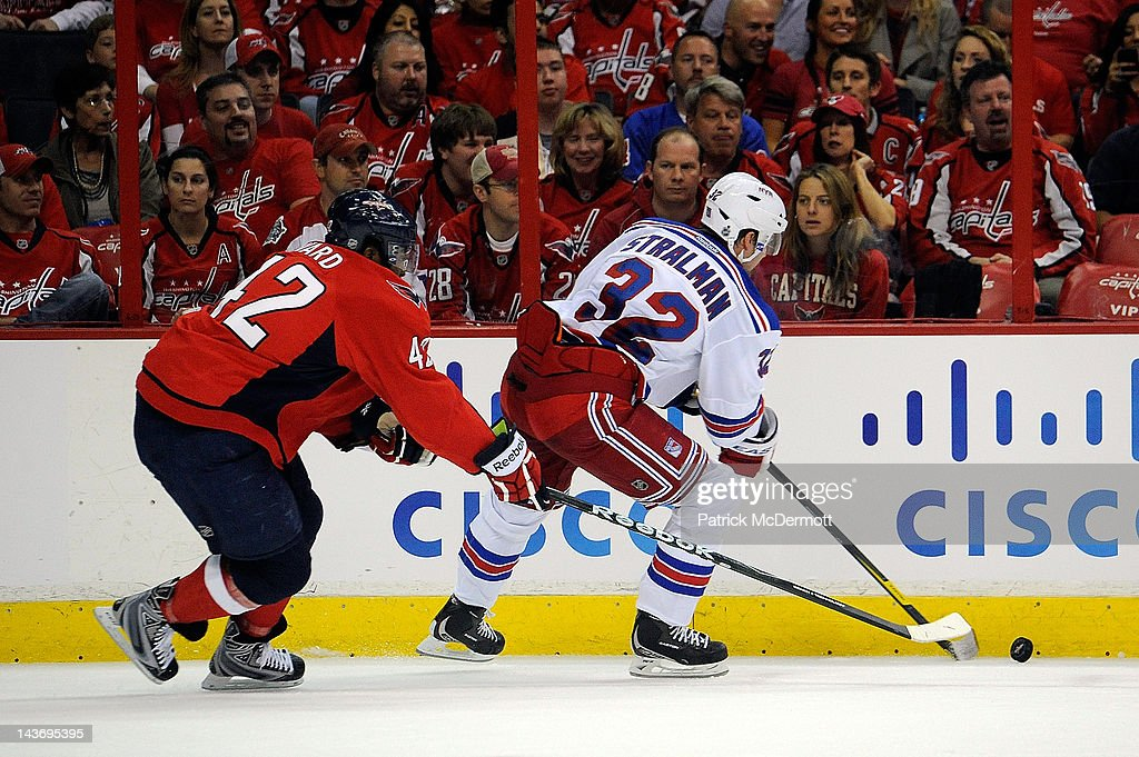 Joel Ward #42 of the Washington Capitals and Anton Stralman #32 of the New York Rangers battle for the puck in Game Three of the Eastern Conference Semifinals during the 2012 NHL Stanley Cup Playoffs at the Verizon Center on May 2, 2012 in Washington, DC.
