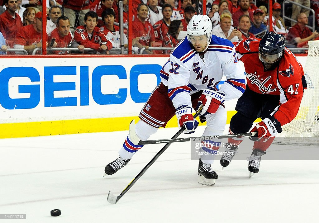 Joel Ward #42 of the Washington Capitals and <a gi-track='captionPersonalityLinkClicked' href=/galleries/search?phrase=Anton+Stralman&family=editorial&specificpeople=2271901 ng-click='$event.stopPropagation()'>Anton Stralman</a> #32 of the New York Rangers battle for the puck in Game Six of the Eastern Conference Semifinals during the 2012 NHL Stanley Cup Playoffs at Verizon Center on May 9, 2012 in Washington, DC.