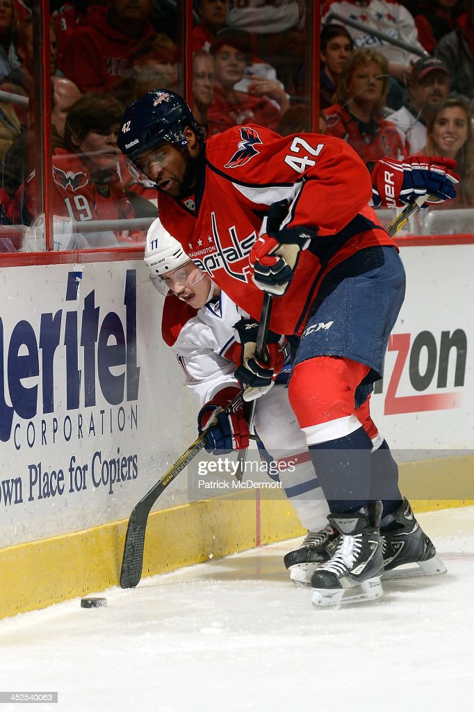 Joel Ward #42 of the Washington Capitals and <a gi-track='captionPersonalityLinkClicked' href=/galleries/search?phrase=Brendan+Gallagher&family=editorial&specificpeople=3704208 ng-click='$event.stopPropagation()'>Brendan Gallagher</a> #11 of the Montreal Canadiens battle for the puck in the third period of an NHL game at Verizon Center on November 29, 2013 in Washington, DC.