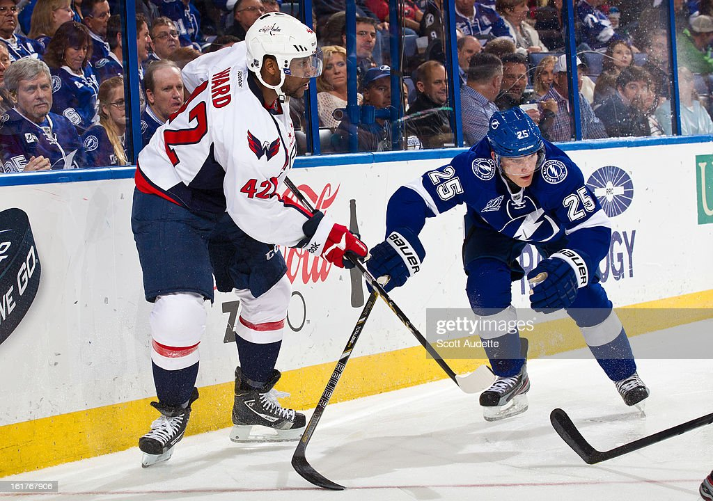 Joel Ward #42 of the Washington Capitals and Matt Carle #25 of the Tampa Bay Lightning fight for position during the second period of the game at the Tampa Bay Times Forum on February 14, 2013 in Tampa, Florida.