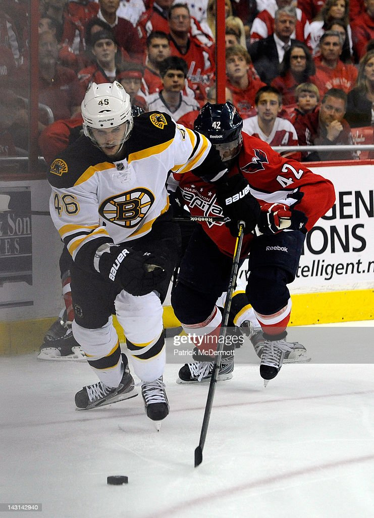 Joel Ward #42 of the Washington Capitals and <a gi-track='captionPersonalityLinkClicked' href=/galleries/search?phrase=Patrice+Bergeron&family=editorial&specificpeople=204162 ng-click='$event.stopPropagation()'>Patrice Bergeron</a> #37 of the Boston Bruins battle during the third peroid of Game Four of the Eastern Conference Quarterfinals during the 2012 NHL Stanley Cup Playoffs at Verizon Center on April 19, 2012 in Washington, DC.