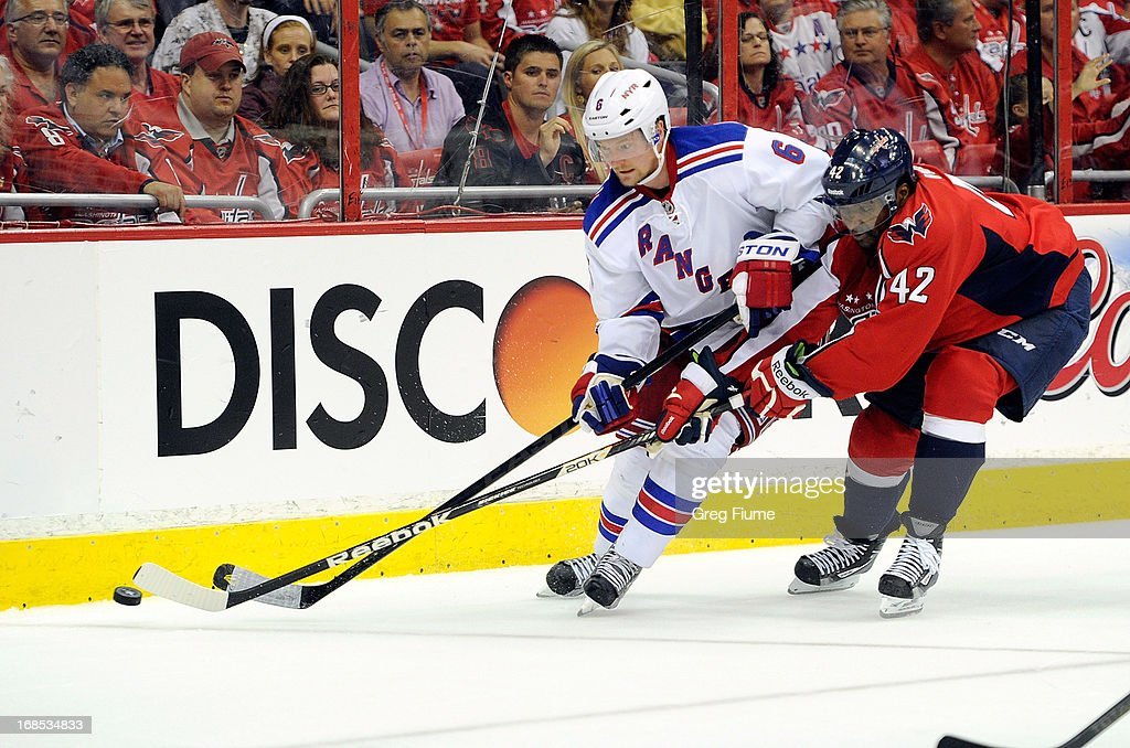 Joel Ward #42 of the Washington Capitals battles for the puck in the third period against <a gi-track='captionPersonalityLinkClicked' href=/galleries/search?phrase=Anton+Stralman&family=editorial&specificpeople=2271901 ng-click='$event.stopPropagation()'>Anton Stralman</a> #6 of the New York Rangers in Game Five of the Eastern Conference Quarterfinals during the 2013 NHL Stanley Cup Playoffs at the Verizon Center on May 10, 2013 in Washington, DC.