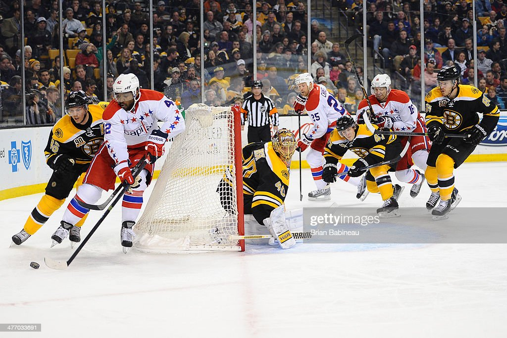 Joel Ward #42 of the Washington Capitals brings the puck around the net as <a gi-track='captionPersonalityLinkClicked' href=/galleries/search?phrase=Tuukka+Rask&family=editorial&specificpeople=716723 ng-click='$event.stopPropagation()'>Tuukka Rask</a> #40 of the Boston Bruins watches the play at the TD Garden on March 6, 2014 in Boston, Massachusetts.