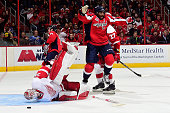 Joel Ward of the Washington Capitals celebrates after Troy Brouwer scored a goal in the second period as goalie Jimmy Howard the Detroit Red Wings...