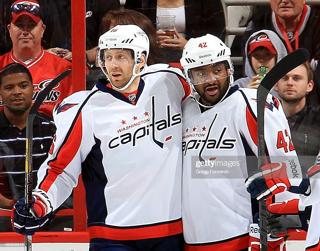 Joel Ward #42 of the Washington Capitals celebrates his first-period goal against the Carolina Hurricanes with teammate <a gi-track='captionPersonalityLinkClicked' href=/galleries/search?phrase=Eric+Fehr&family=editorial&specificpeople=566939 ng-click='$event.stopPropagation()'>Eric Fehr</a> #16 during their NHL game at PNC Arena on April 10, 2014 in Raleigh, North Carolina.