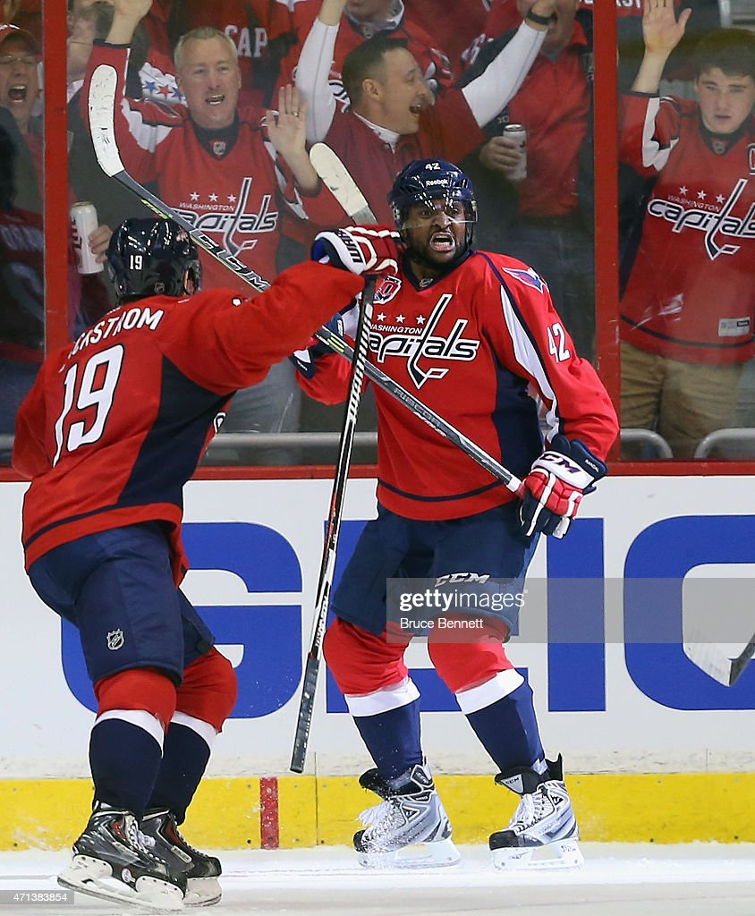<a gi-track='captionPersonalityLinkClicked' href=/galleries/search?phrase=Joel+Ward+-+Ice+Hockey+Player&family=editorial&specificpeople=7231959 ng-click='$event.stopPropagation()'>Joel Ward</a> #42 of the Washington Capitals celebrates his goal at 18:35 of the second period against the New York Islanders in Game Seven of the Eastern Conference Quarterfinals during the 2015 NHL Stanley Cup Playoffs at Verizon Center on April 27, 2015 in Washington, DC.