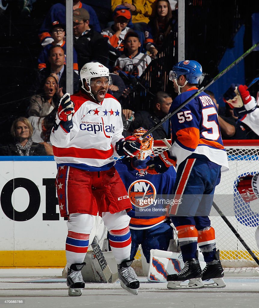 <a gi-track='captionPersonalityLinkClicked' href=/galleries/search?phrase=Joel+Ward+-+Ice+Hockey+Player&family=editorial&specificpeople=7231959 ng-click='$event.stopPropagation()'>Joel Ward</a> #42 of the Washington Capitals celebrates the game winning overtime goal at 11:09 of the first overtime period by Nicklas Backstrom #19 (not shown) against the New York Islanders in Game Four of the Eastern Conference Quarterfinals during the 2015 NHL Stanley Cup Playoffs at Nassau Veterans Memorial Coliseum on April 21, 2015 in Uniondale, New York. The Capitals defeated the Islanders 2-1 in overtime. Joining Backstrom is Brooks Orpik #44.