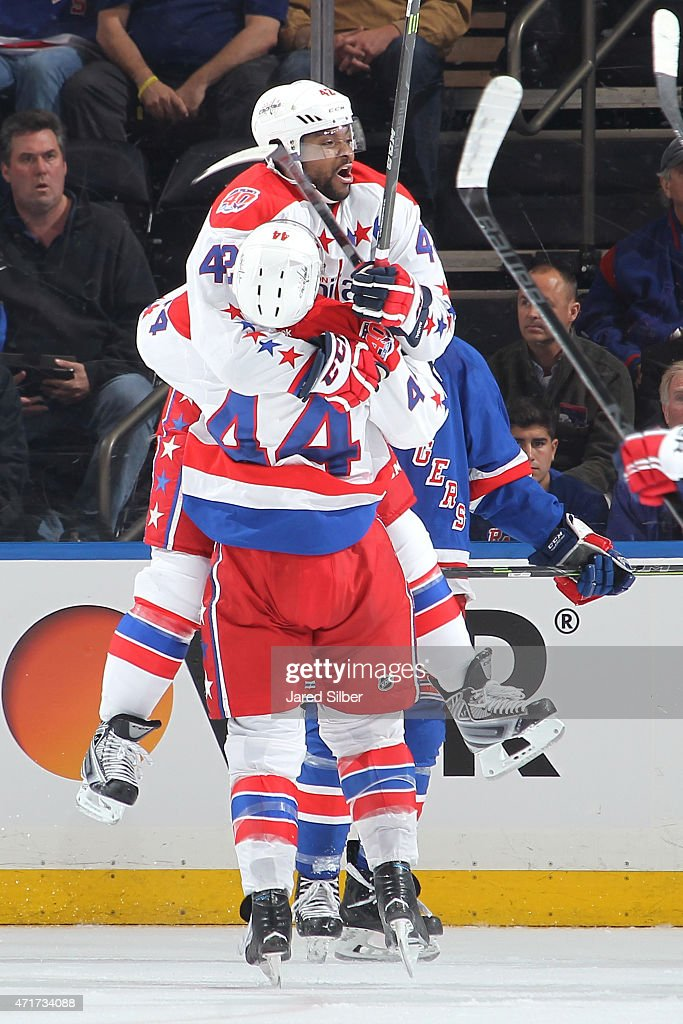 Joel Ward of the Washington Capitals celebrates with Brooks Orpik after scoring in the final seconds of the third period to help defeat the New York...