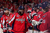 Joel Ward of the Washington Capitals celebrates with his teammates after scoring a goal against the New York Rangers during the third period in Game...