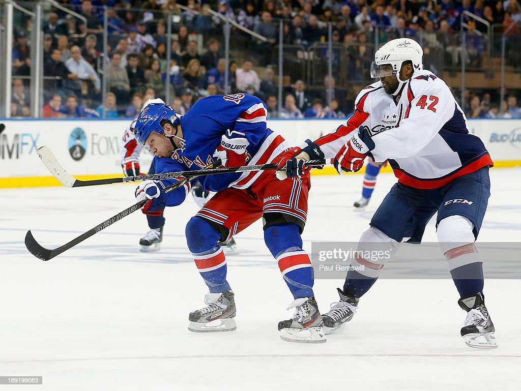 Joel Ward #42 of the Washington Capitals checks Derek Dorsett #15 of the New York Rangers in Game Six of the Eastern Conference Quarterfinals during the 2013 NHL Stanley Cup Playoffs at Madison Square Garden on May 12, 2013 in New York City.