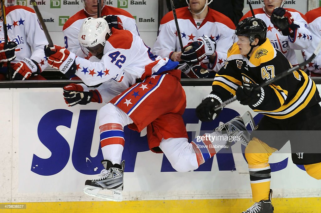 Joel Ward #42 of the Washington Capitals checks into the boards against <a gi-track='captionPersonalityLinkClicked' href=/galleries/search?phrase=Torey+Krug&family=editorial&specificpeople=6670036 ng-click='$event.stopPropagation()'>Torey Krug</a> #47 of the Boston Bruins at the TD Garden on March 1, 2014 in Boston, Massachusetts.