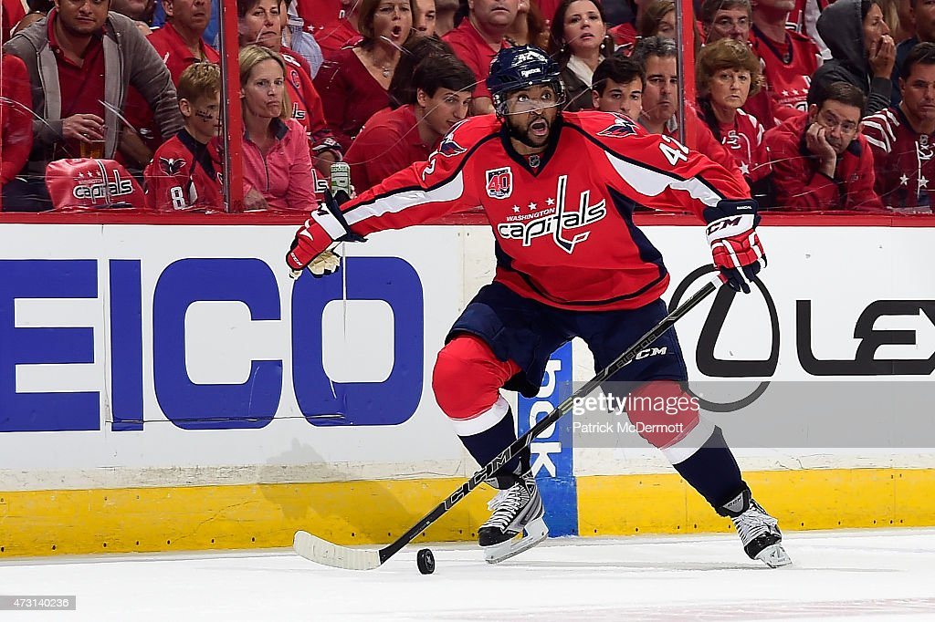 Joel Ward of the Washington Capitals controls the puck against the New York Rangers during the second period in Game Six of the Eastern Conference...