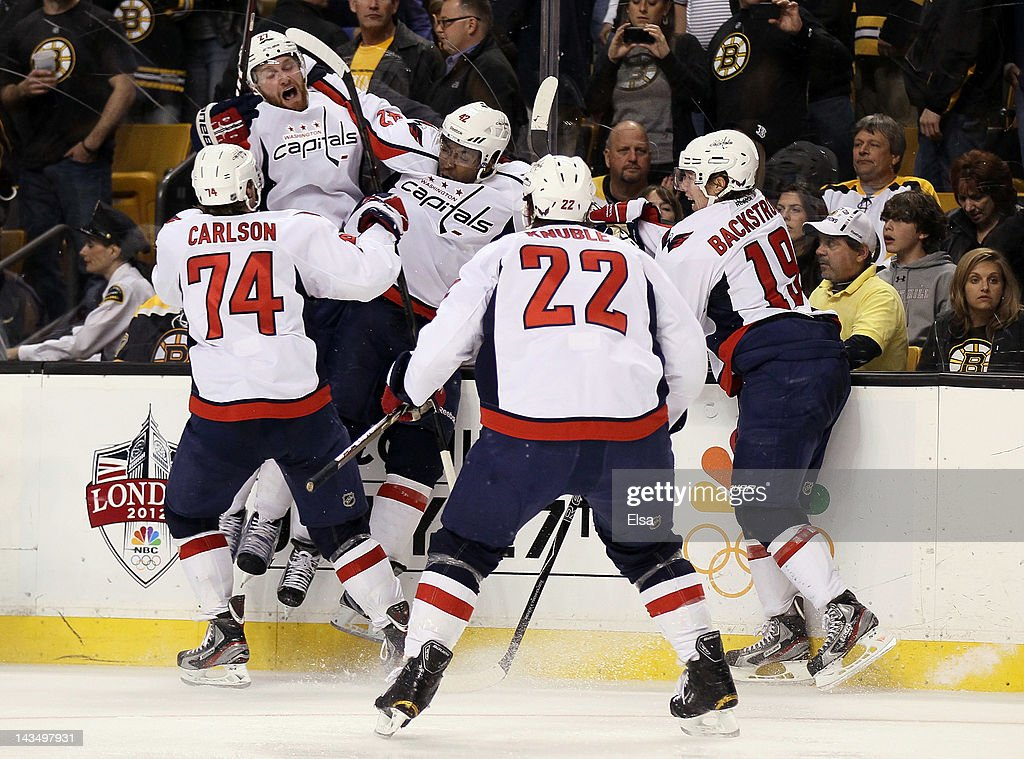 Joel Ward #42 of the Washington Capitals is congratulated after he scored the game winning goal against the Boston Bruins in Game Seven of the Eastern Conference Quarterfinals during the 2012 NHL Stanley Cup Playoffs at TD Garden on April 25, 2012 in Boston, Massachusetts. The Washington Capitals defeated the Boston Bruins 2-1 in overtime.