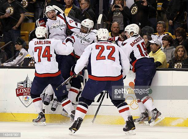 Joel Ward of the Washington Capitals is congratulated after he scored the game winning goal against the Boston Bruins in Game Seven of the Eastern...