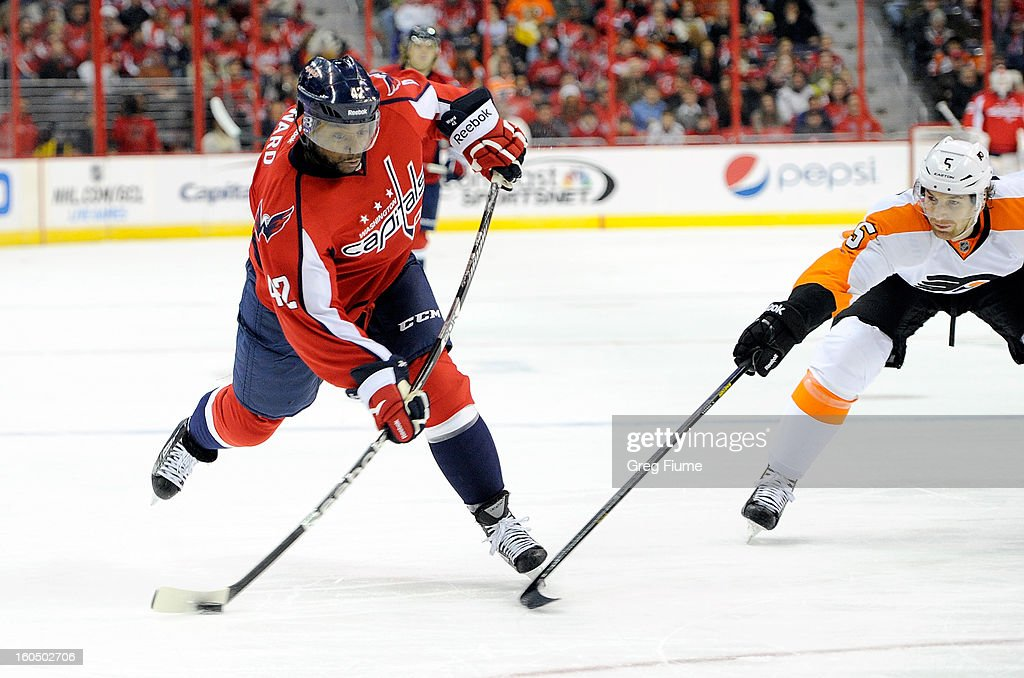 Joel Ward #42 of the Washington Capitals shoots the puck against <a gi-track='captionPersonalityLinkClicked' href=/galleries/search?phrase=Braydon+Coburn&family=editorial&specificpeople=2077063 ng-click='$event.stopPropagation()'>Braydon Coburn</a> #5 of the Philadelphia Flyers at the Verizon Center on February 1, 2013 in Washington, DC.