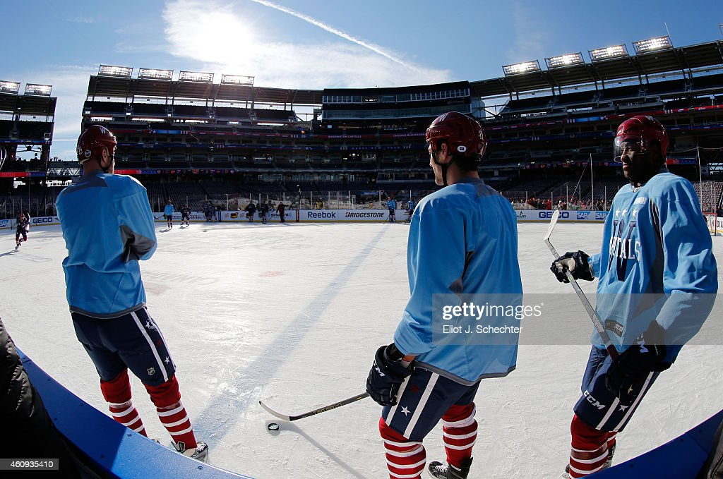 <a gi-track='captionPersonalityLinkClicked' href=/galleries/search?phrase=Joel+Ward+-+Ice+Hockey+Player&family=editorial&specificpeople=7231959 ng-click='$event.stopPropagation()'>Joel Ward</a> #42 of the Washington Capitals (R) skates with teammates during practice day prior to the 2015 Bridgestone NHL Winter Classic on December 31, 2014 in Washington, D.C. The 2015 Bridgestone NHL Winter Classic will take place on New Year's Day with the Washington Capitals playing the Chicago Blackhawks.