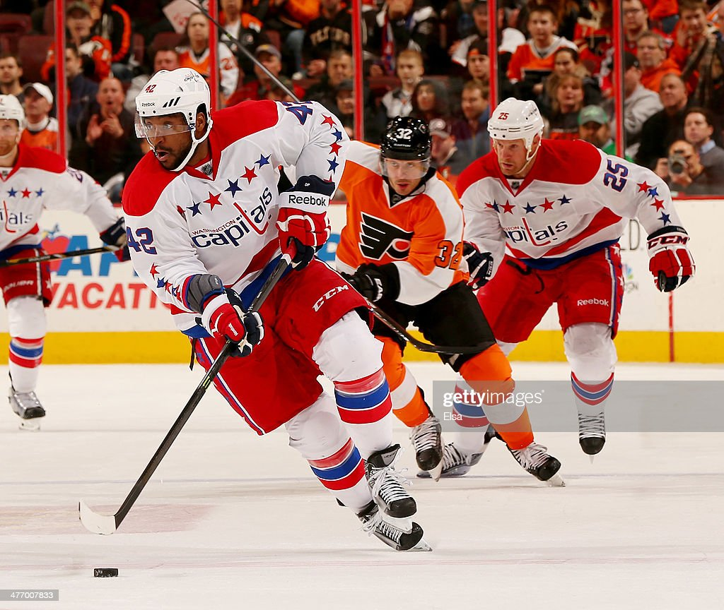 Joel Ward #42 of the Washington Capitals takes the puck in the third period against the Philadelphia Flyers at Wells Fargo Center on March 5, 2014 in Philadelphia, Pennsylvania.The Philadelphia Flyers defeated the Washington Capitals 6-4.