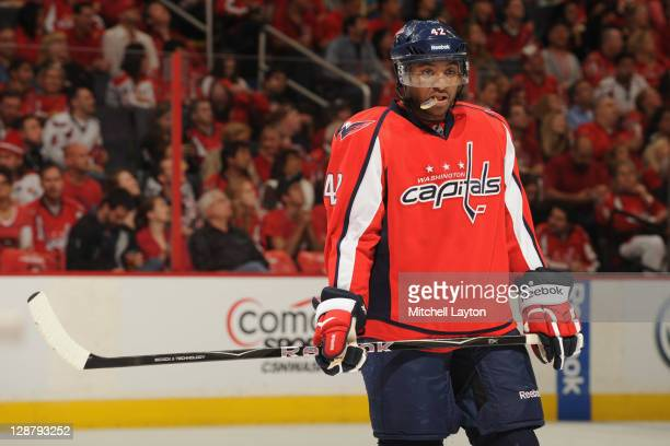Joel Ward of the Washington Capitals waits on the ice after the Carolina Hurricanes scored during a NHL hockey game on October 8 2011 at the Verizon...
