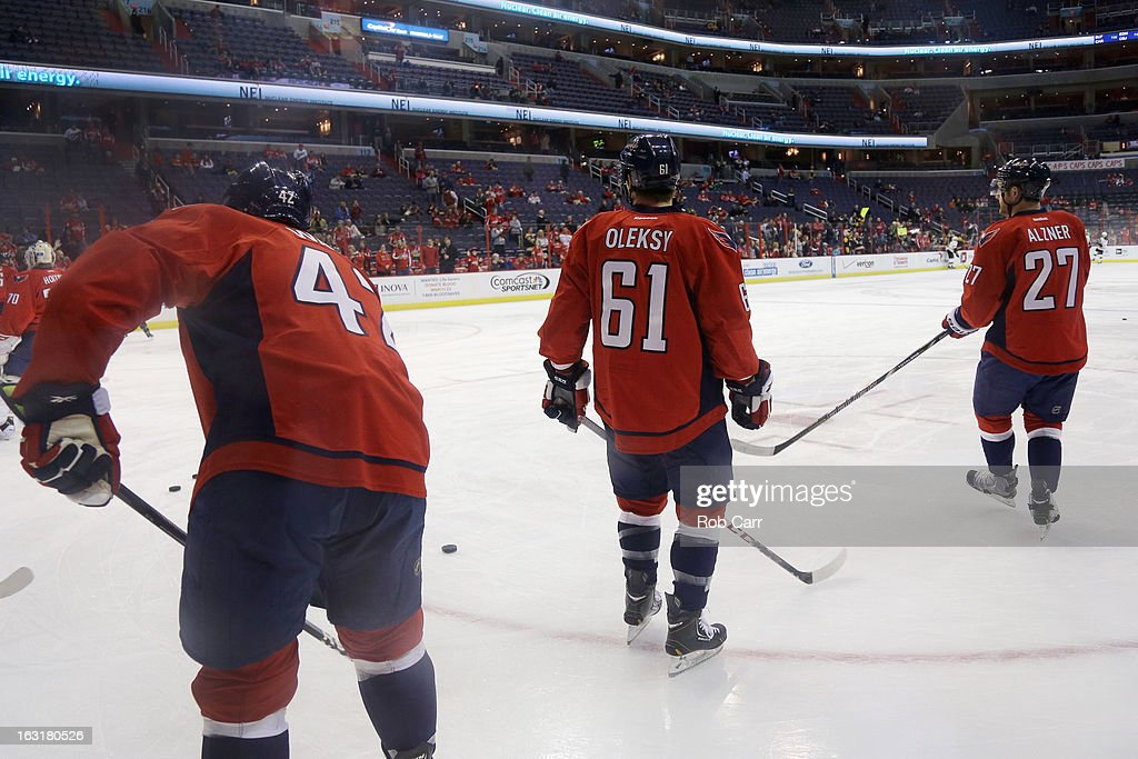 Joel Ward #42, Steven Oleksy #61, and <a gi-track='captionPersonalityLinkClicked' href=/galleries/search?phrase=Karl+Alzner&family=editorial&specificpeople=3938829 ng-click='$event.stopPropagation()'>Karl Alzner</a> #27 of the Washington Capitals skate on the ice during warmups before the start of the Capitals game against the Boston Bruins at Verizon Center on March 5, 2013 in Washington, DC.