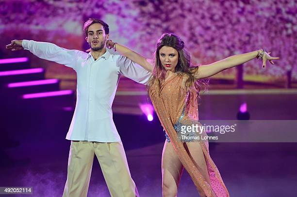 Joelina Drews and Marc Aurel Zeeb performe with a rumba dance during the fith show of the television competition 'Stepping Out' on October 9 2015 in...