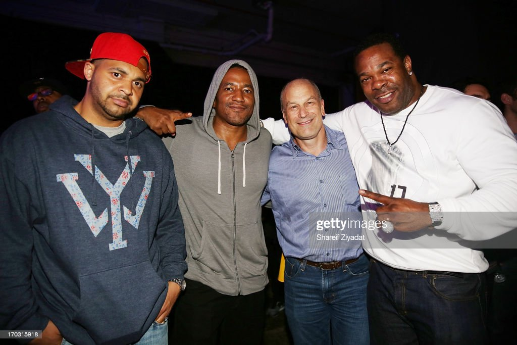 Joell Ortiz, Q-Tip, Barry Weiss and <a gi-track='captionPersonalityLinkClicked' href=/galleries/search?phrase=Busta+Rhymes&family=editorial&specificpeople=208120 ng-click='$event.stopPropagation()'>Busta Rhymes</a> attend the Kanye West album listening party at Milk Studios on June 10, 2013 in New York City.