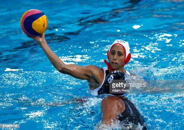 Joelle Bekhazi of Canada shoots past Caitlin Lopes Da Silva of New Zealand during the Women's Water Polo preliminary round match between Canada and...