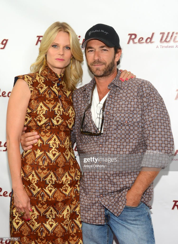 <a gi-track='captionPersonalityLinkClicked' href=/galleries/search?phrase=Joelle+Carter&family=editorial&specificpeople=2433556 ng-click='$event.stopPropagation()'>Joelle Carter</a> and <a gi-track='captionPersonalityLinkClicked' href=/galleries/search?phrase=Luke+Perry&family=editorial&specificpeople=171633 ng-click='$event.stopPropagation()'>Luke Perry</a> attend a screening of Integrity Film Production's 'Red Wing' at Harmony Gold Theatre on August 6, 2013 in Los Angeles, California.