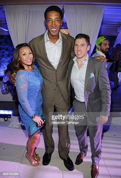 Joelle Silva Scottie Pippen and Adam Bossi pose at the Haute Living OMEGA Dark Side of the Moon Watch event hosted by Larsa and Scottie Pippen on...