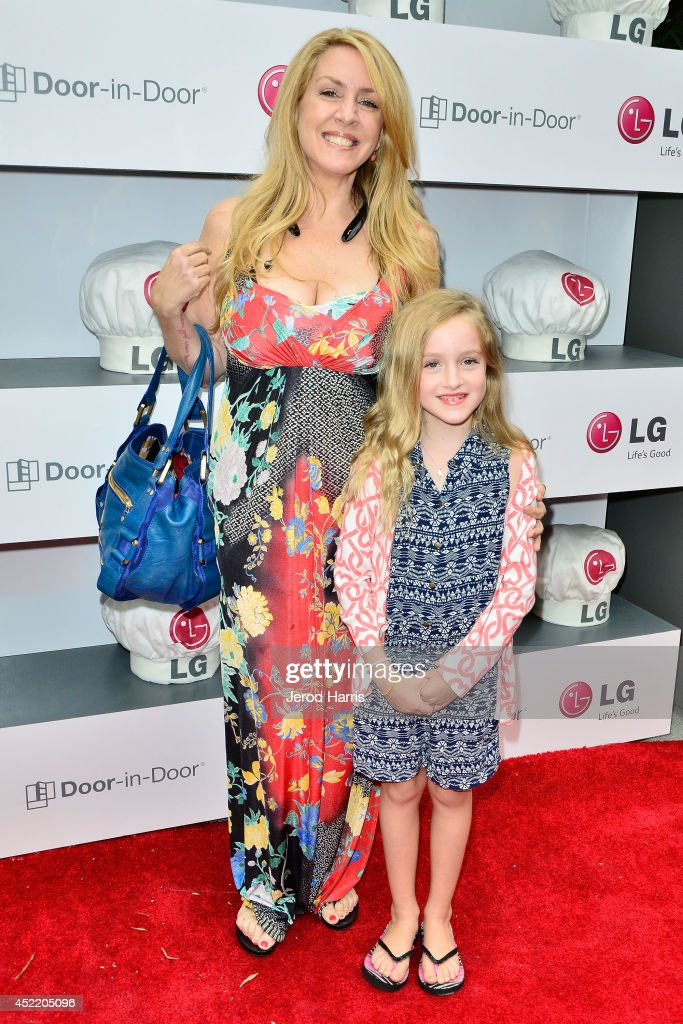 Joely Fisher and daughter Skyler Grace attend LG and Chef Sandra Lee Host LG Junior Chef Academy to celebrate the launch of the Door-in-Door Refrigerator with CustomChill, Benefiting No Kid Hungry at The Washbow on July 15, 2014 in Culver City, California.