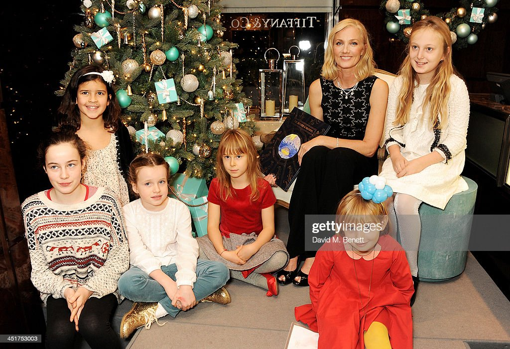 Joely Richardson (3R) poses with children as she officially opens the Tiffany & Co. Christmas Shop on Bond Street, London on November 24, 2013 in London, England.