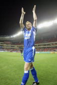 Joerg Albertz appearing for Shanghai Shenhua applauds the crowd after the friendly match between Germany`s Hamburg HSV and Shanghai Shenhua on May 26...