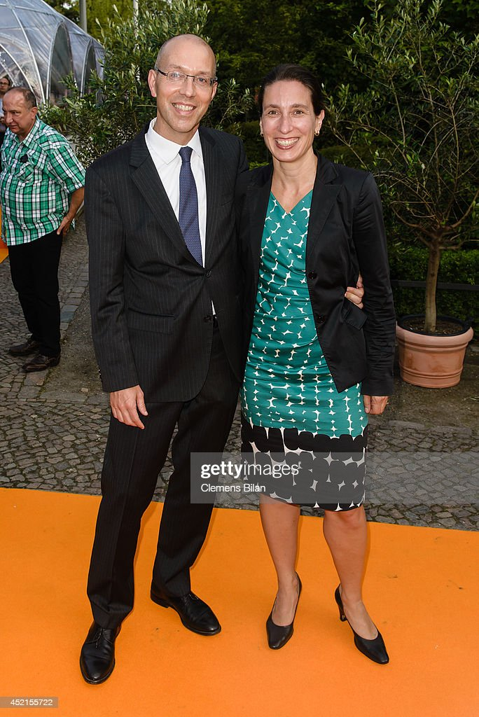 Joerg Asmussen (L) and Henriette Peucker attend the ZDF Summer Reception on July 14, 2014 in Berlin, Germany.