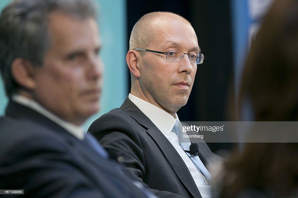 Joerg Asmussen, executive board member of the European Central Bank (ECB), center, and David Lipton, first deputy managing director of the International Monetary Fund (IMF), left, listen at a Eurozone panel discussion during the IMF and World Bank Group Spring Meetings in Washington, D.C., U.S., on Saturday, April 20, 2013. The IMF's Managing Director said the euro area has the only central bank with enough leeway to take more measures to boost growth as low interest rates fail to trickle down to the region's economy. Photographer: Andrew Harrer/Bloomberg via Getty Images