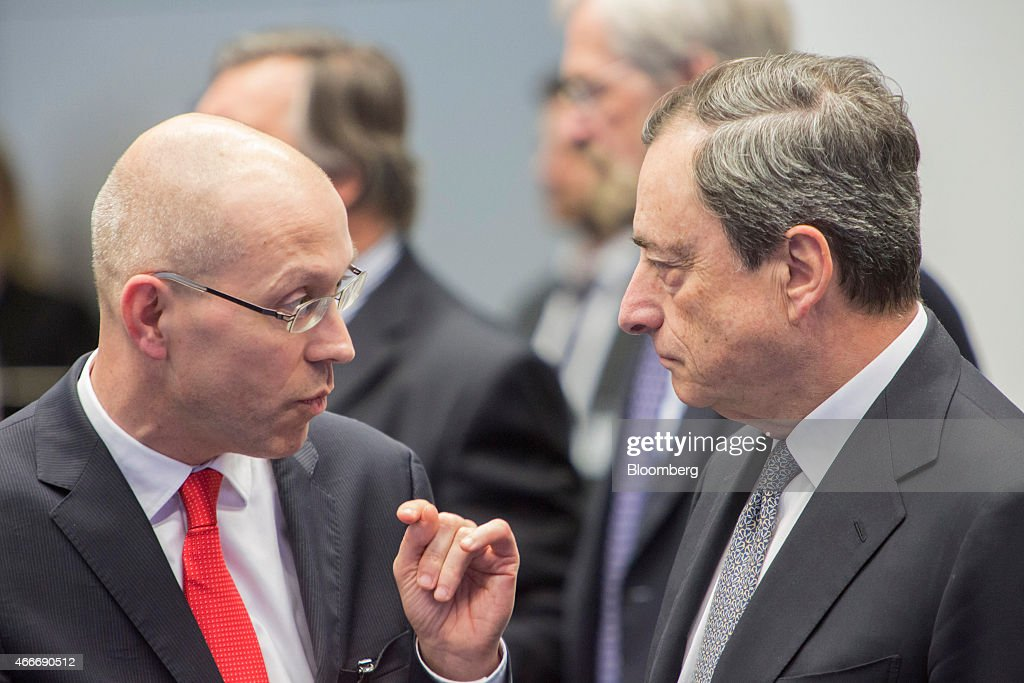 Joerg Asmussen, Germany's deputy labor minister, left, speaks with <a gi-track='captionPersonalityLinkClicked' href=/galleries/search?phrase=Mario+Draghi&family=editorial&specificpeople=571678 ng-click='$event.stopPropagation()'>Mario Draghi</a>, president of the European Central Bank (ECB), ahead of the inauguration ceremony for the new European Central Bank headquarters in Frankfurt, Germany, on Wednesday, March 18, 2015. Anti-austerity protesters seeking to spoil the inauguration of the European Central Bank's new headquarters in Frankfurt's east end set vehicles alight, erected barricades and left a trail of destruction across the city. Photographer: Martin Leissl/Bloomberg via Getty Images
