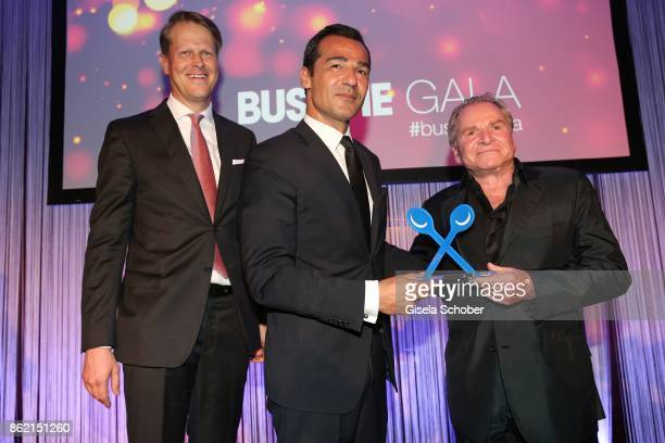 Joerg Leu Marketing director Busche Verlag Erol Sander with award and Fritz Wepper during the 2oth 'Busche Gala' at The Charles Hotel on October 16...