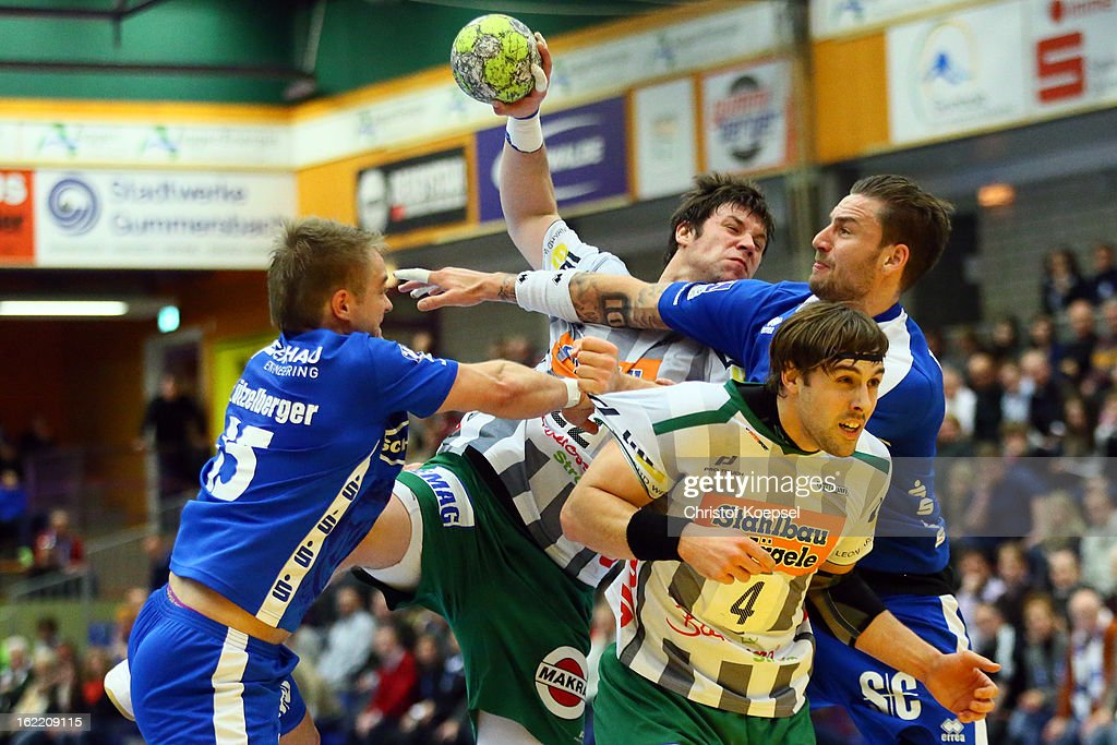 Joerg Luetzelberger of Gummersbach (L) and Dennis Krause of Gummersbach (R) defend against Momir Rnic (2nd L) and Tim Kneule (2nd R) of Goeppingen during the DKB Handball Bundesliga match between VfL Gummersbach and FrischAuf Goeppingen at Eugen-Haas-Sporthalle on February 20, 2013 in Gummersbach, Germany.