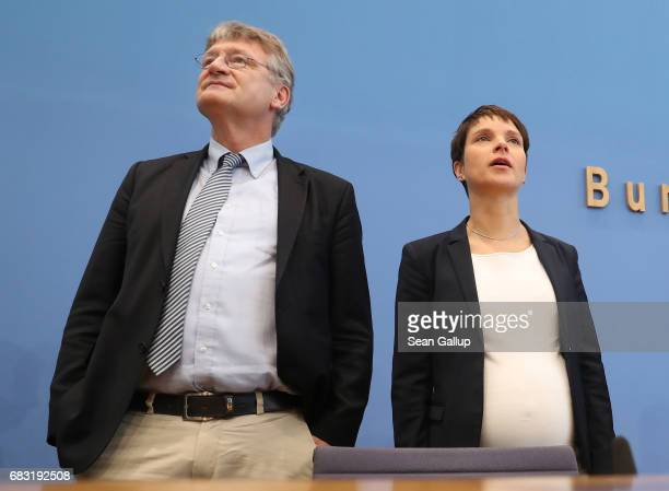 Joerg Meuthen and Frauke Petry the leadership duo of the populist Alternative for Germany political party arrive to speak to the media the day after...