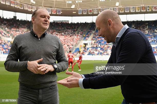 Joerg Schmadtke of 1 FC Koeln and Alexander Rosen of 1899 Hoffenheim joke prior to kickoff during the Bundesliga match between 1899 Hoffenheim and 1...
