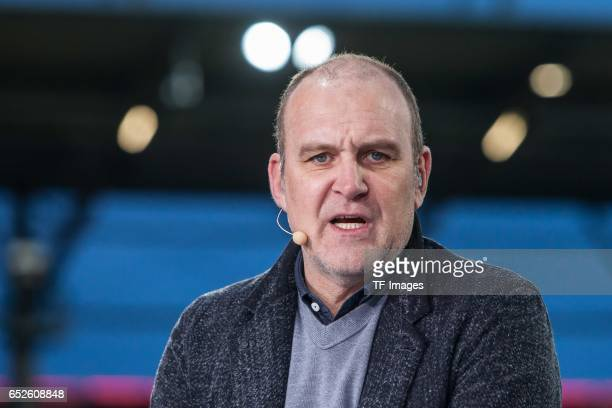 Joerg Schmadtke of Cologne look on during the Bundesliga match between FC Ingolstadt 04 and 1 FC Koeln at Audi Sportpark on March 11 2017 in...