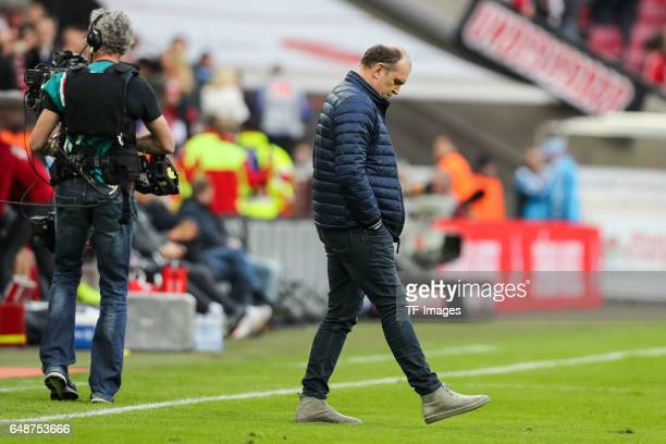 Joerg Schmadtke of Cologne looks on during the Bundesliga match between 1 FC Koeln and Bayern Muenchen at RheinEnergieStadion on March 4 2017 in...