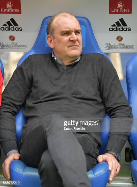 Joerg Schmadtke sports director of Cologne looks troubled during the Bundesliga match between Hamburger SV and 1 FC Koeln at Volksparkstadion on...