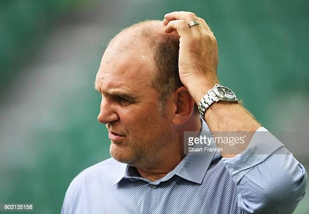 Joerg Schmadtke sports director of Cologne ponders during the Bundesliga match between VfL Wolfsburg and 1 FC Koeln at Volkswagen Arena on September...