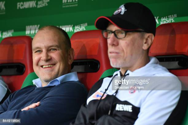 Joerg Schmadtke sports director of Koeln and head coach Peter Stoeger of Koeln look in opposite directions during the Bundesliga match between FC...