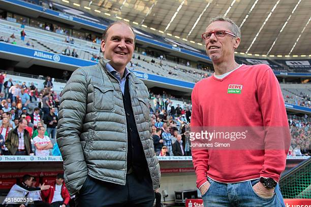 Joerg Schmadtke team manager of Koeln and Peter Stoeger head coach of Koeln chat together ahead of the Second Bundesliga match between TSV 1860...